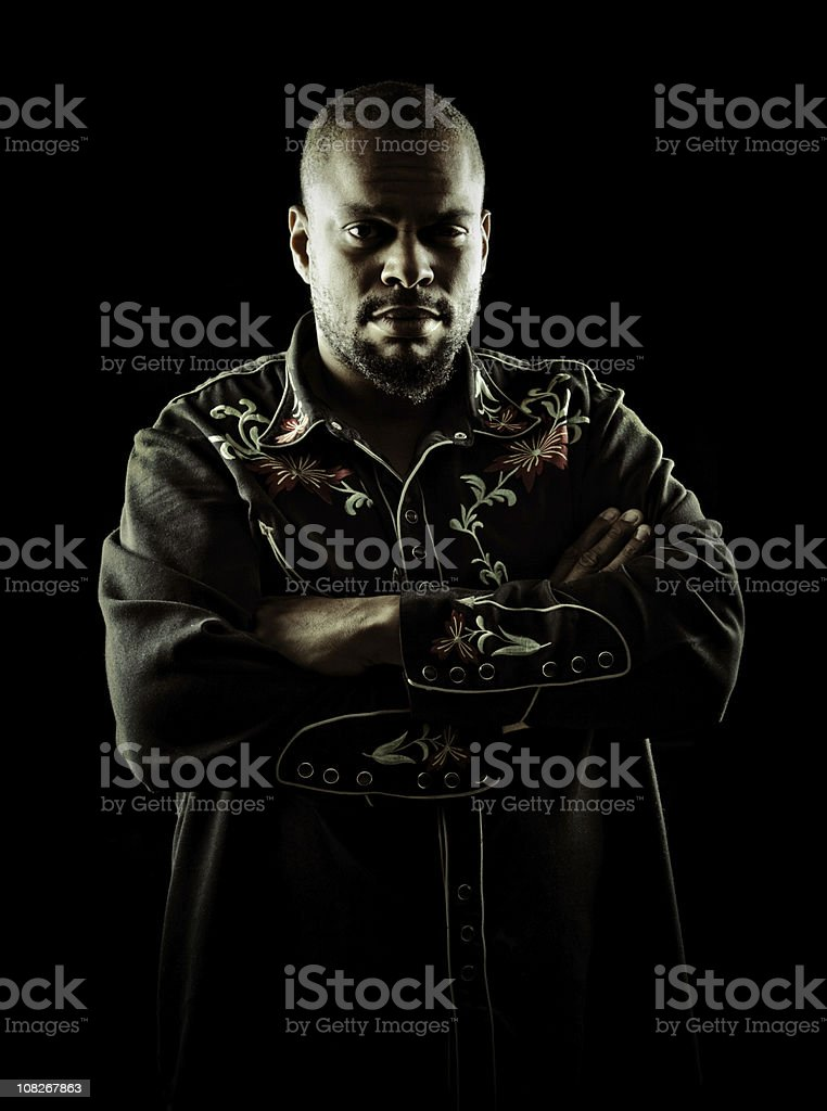 young man with crossed arms stock photo
