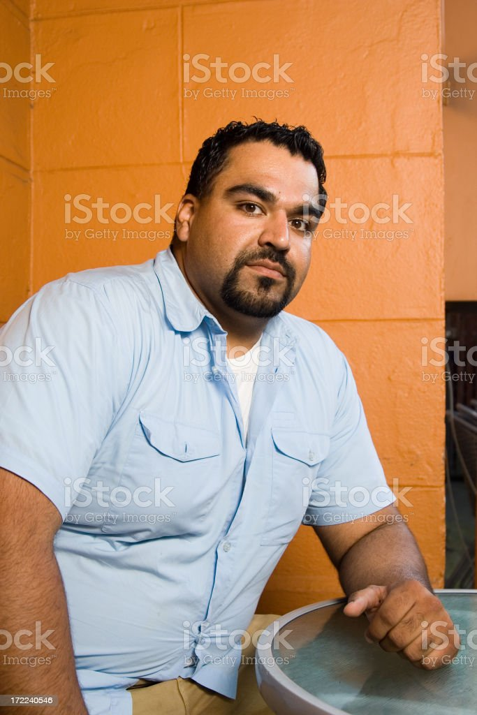 A young man with dark skin and a black beard royalty-free stock photo