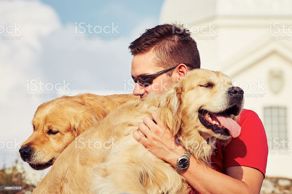 Young man with dogs stock photo