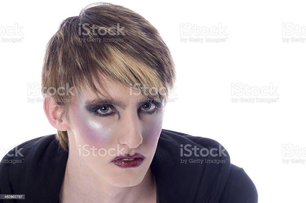 Young man with dramatic glamour makeup. stock photo