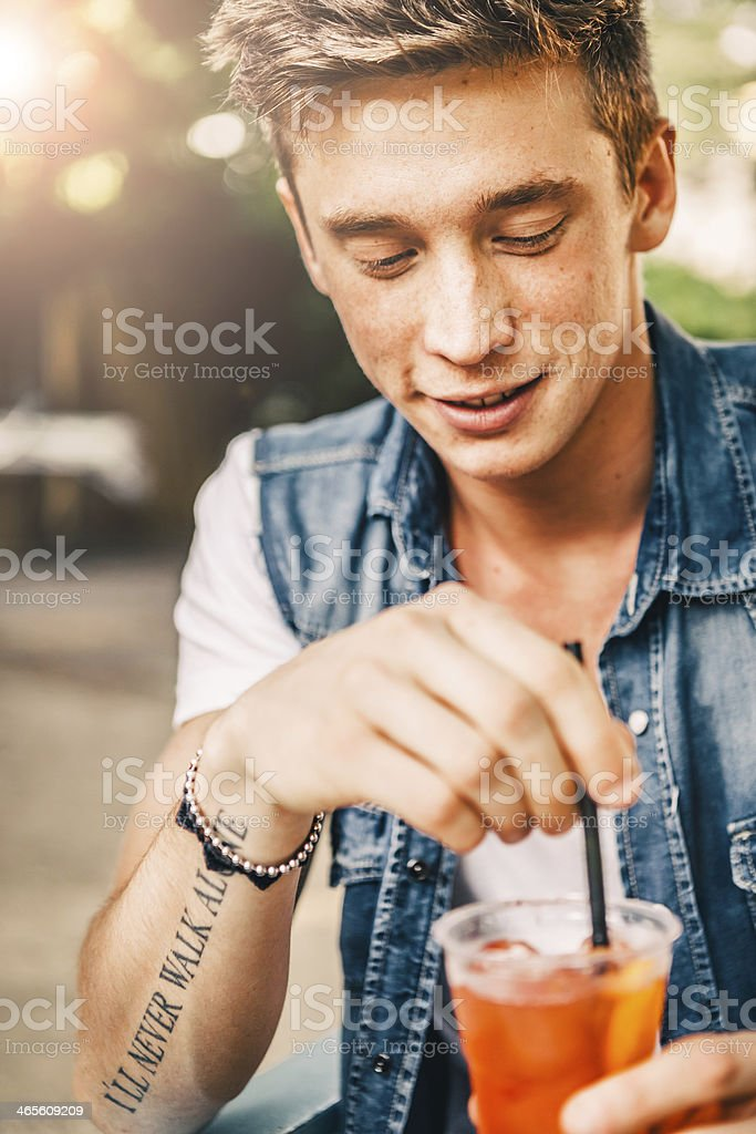 Young Man with Drink at the Ourdoor Cafe royalty-free stock photo