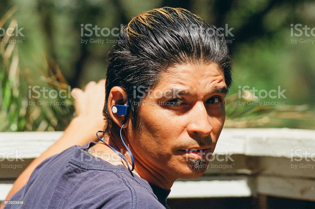 Young Man with Ear Buds stock photo