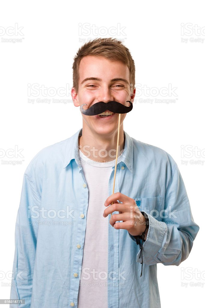 Young man with fake mustaches stock photo