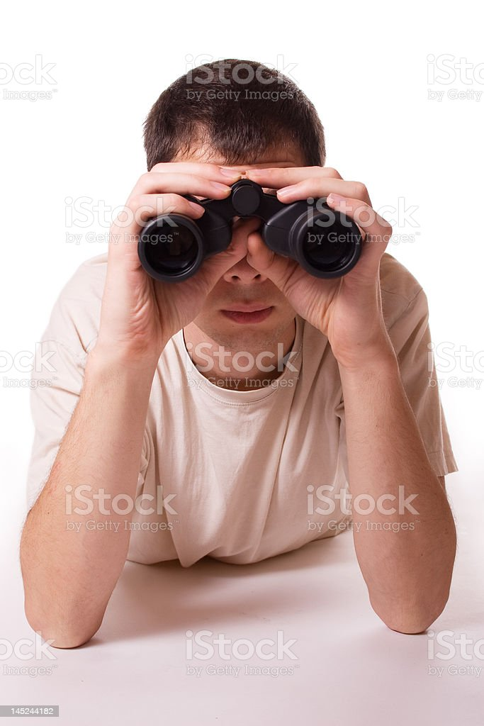 Young man with field glass stock photo