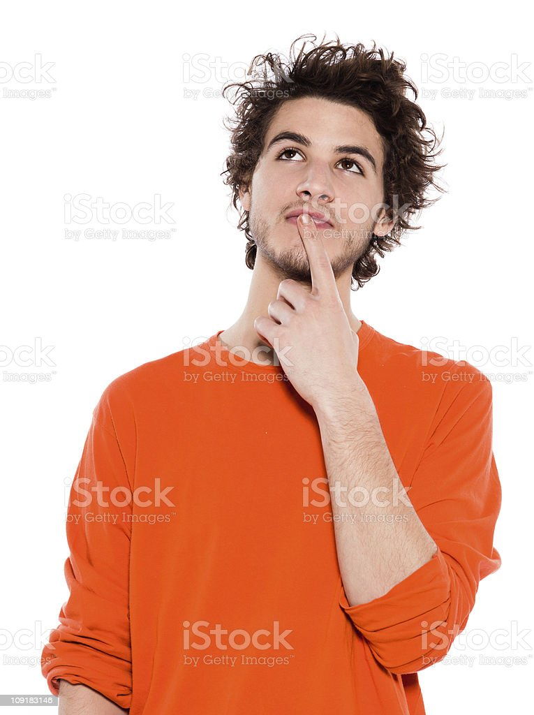 Young man with finger to mouth long hair in orange royalty-free stock photo