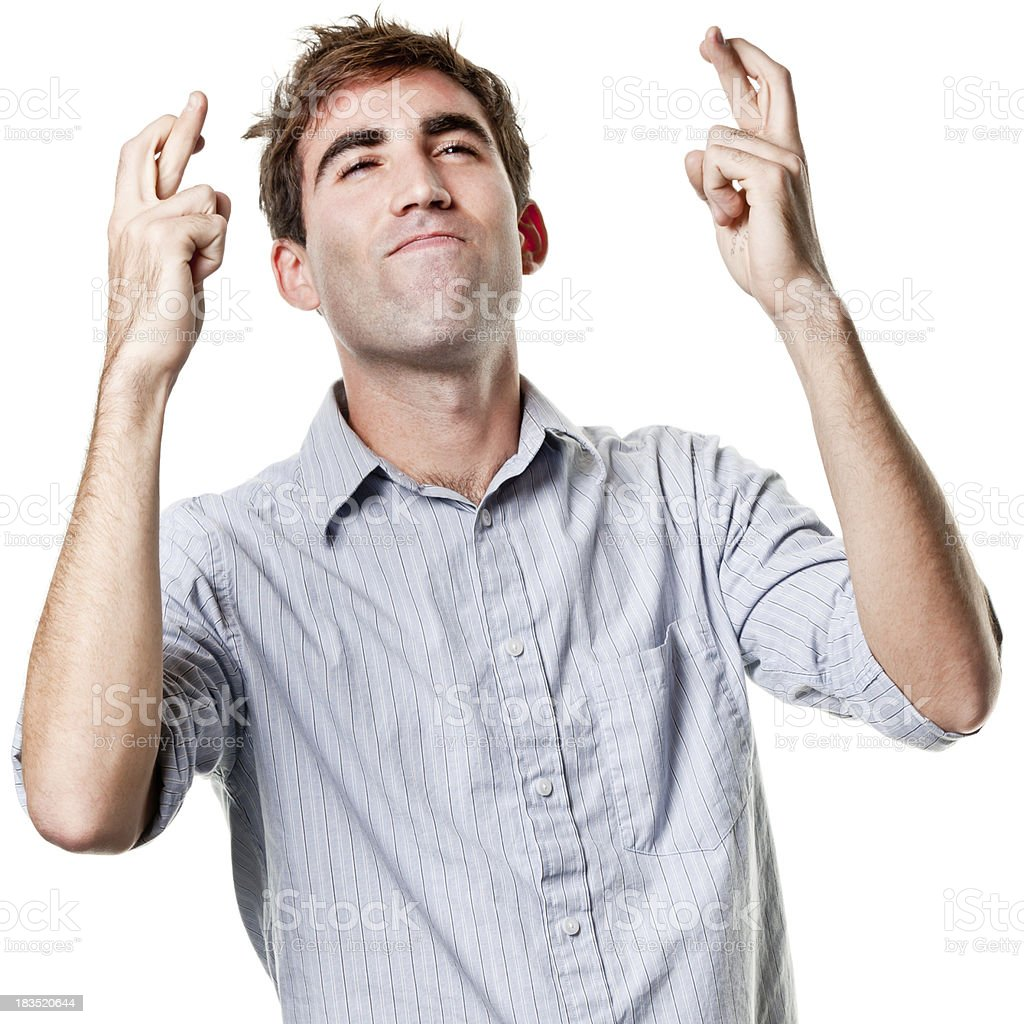 Young Man With Fingers Crossed, Hoping, Wishing stock photo