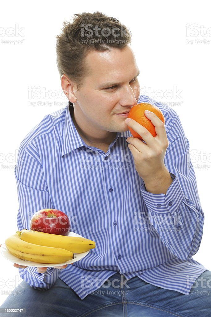 young man with fruits healthy diet isolated royalty-free stock photo