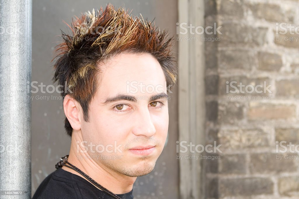 Young Man With Funky Died and Spiked Hair stock photo