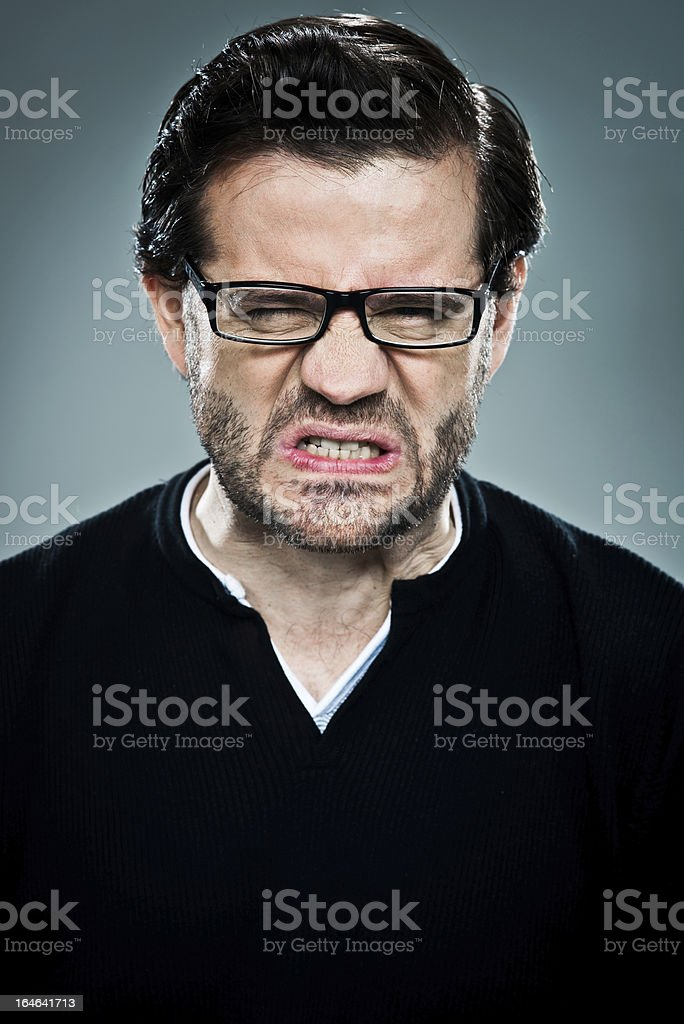 Young Man with Furious Expression royalty-free stock photo