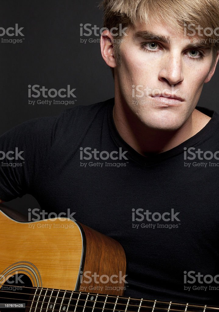 Young Man with Guitar, Handsome, Musician, Pensive royalty-free stock photo