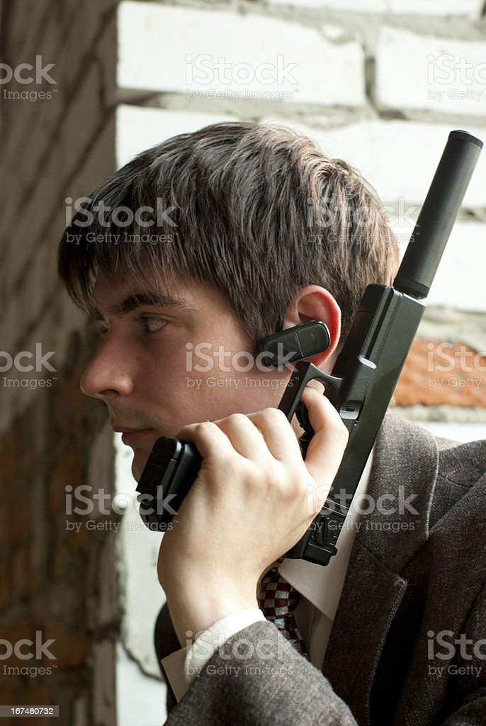 young man with gun stock photo
