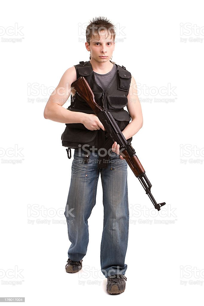 Young man with gun royalty-free stock photo