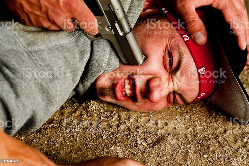 Young Man with Gun to His Head royalty-free stock photo