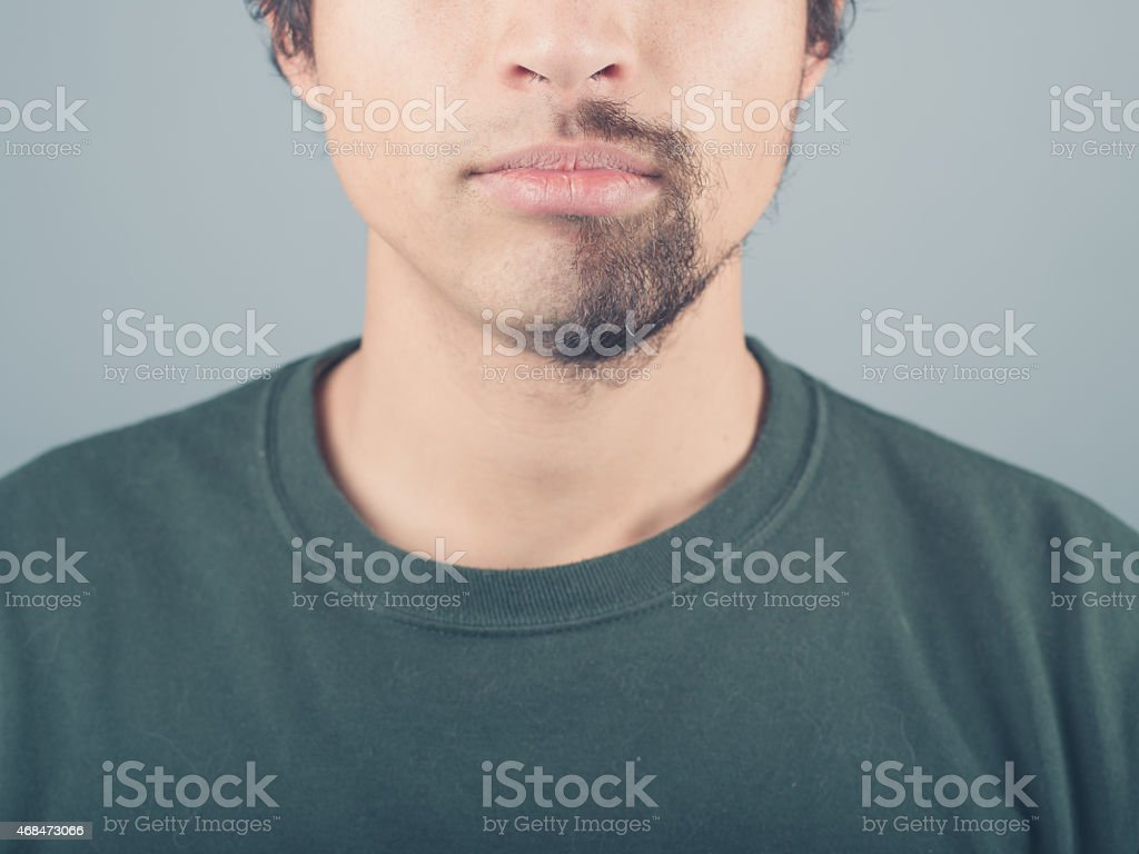 Young man with half shaved beard stock photo
