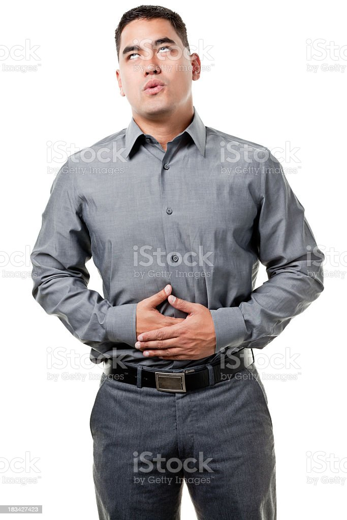 Young Man With Hands On Stomach stock photo
