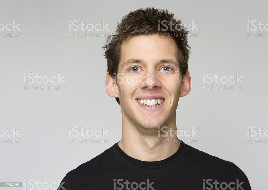 Young man with happy expression stock photo