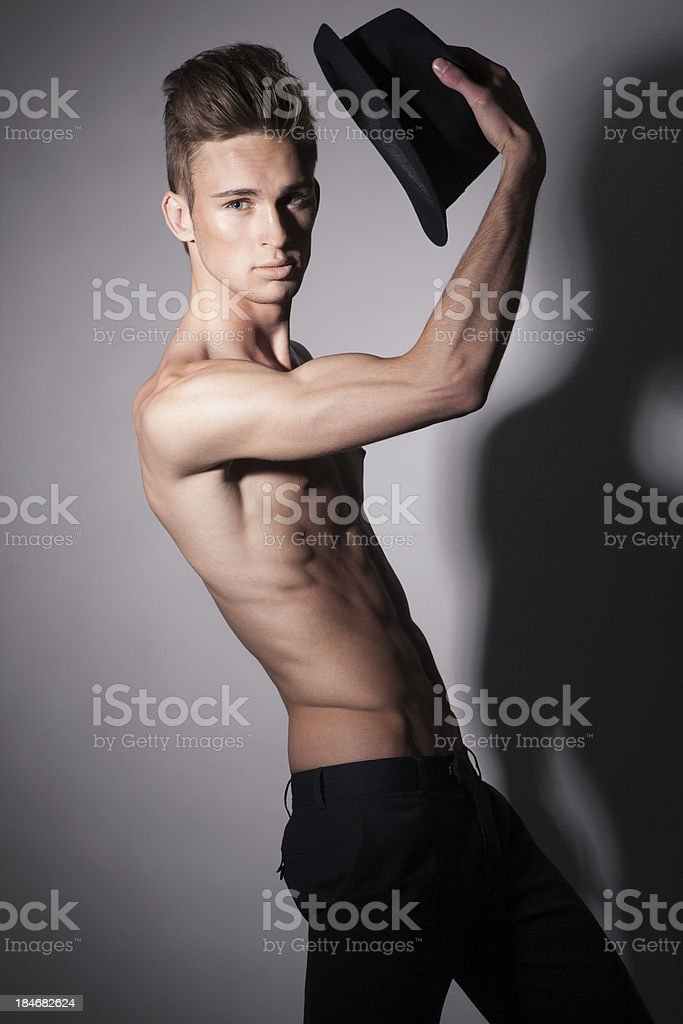 Young man with hat in his hand royalty-free stock photo
