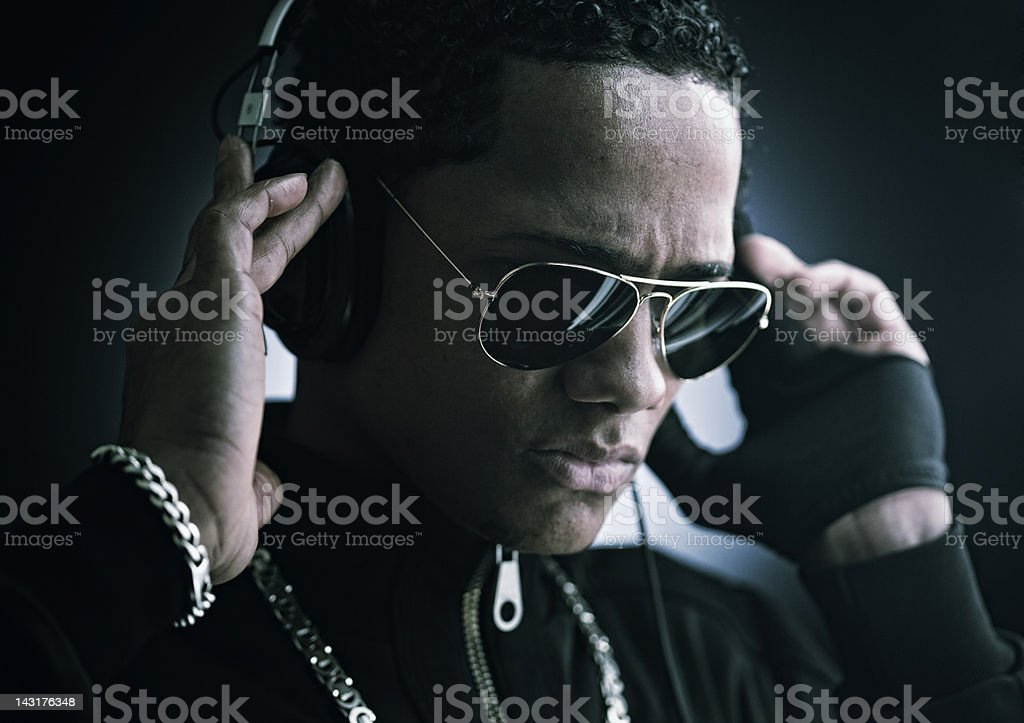 Young man with headphones and sunglasses _ horizontal stock photo