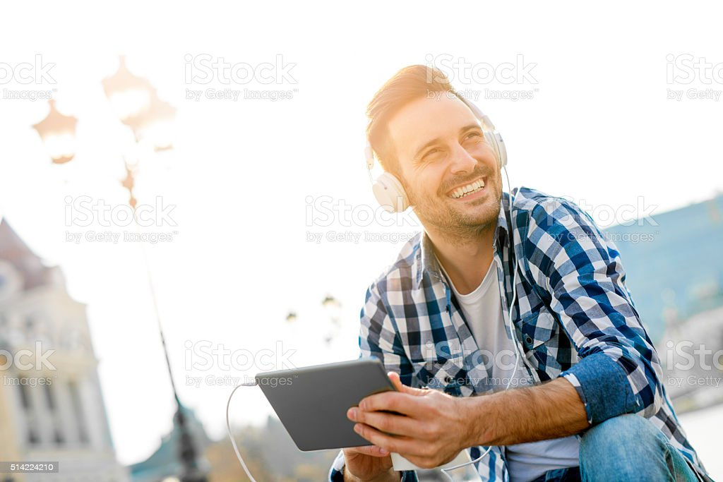 Young man with headphones enjoying the music stock photo