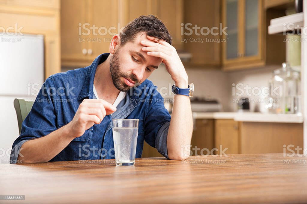 Young man with heartburn stock photo