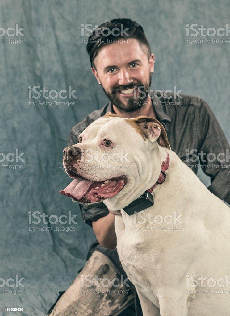 Young Man With His Bulldog Pet stock photo