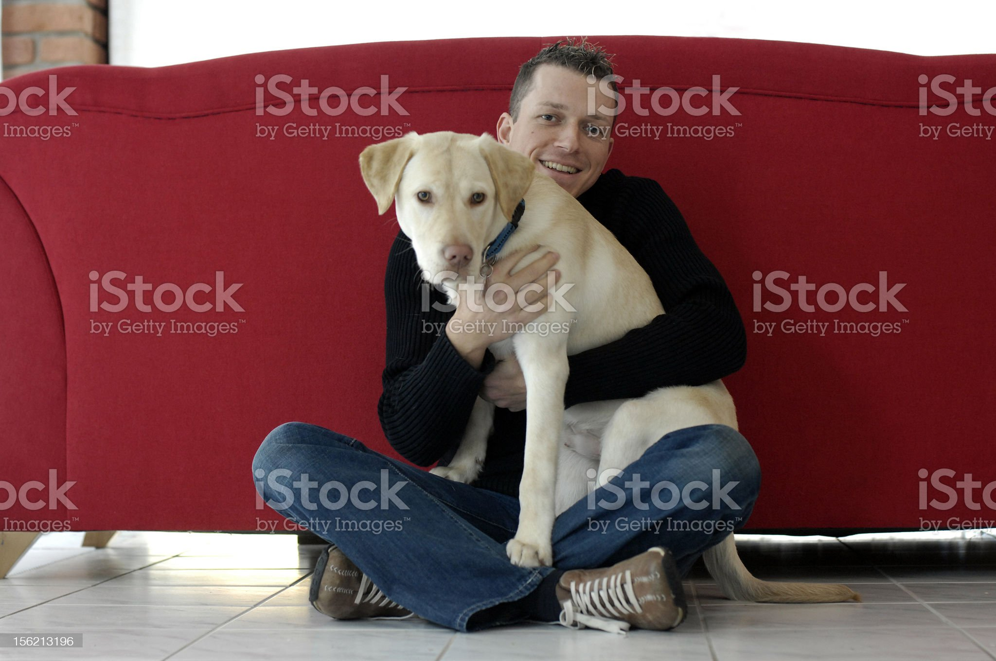 Young man with his dog (Golden Retriever ) royalty-free stock photo