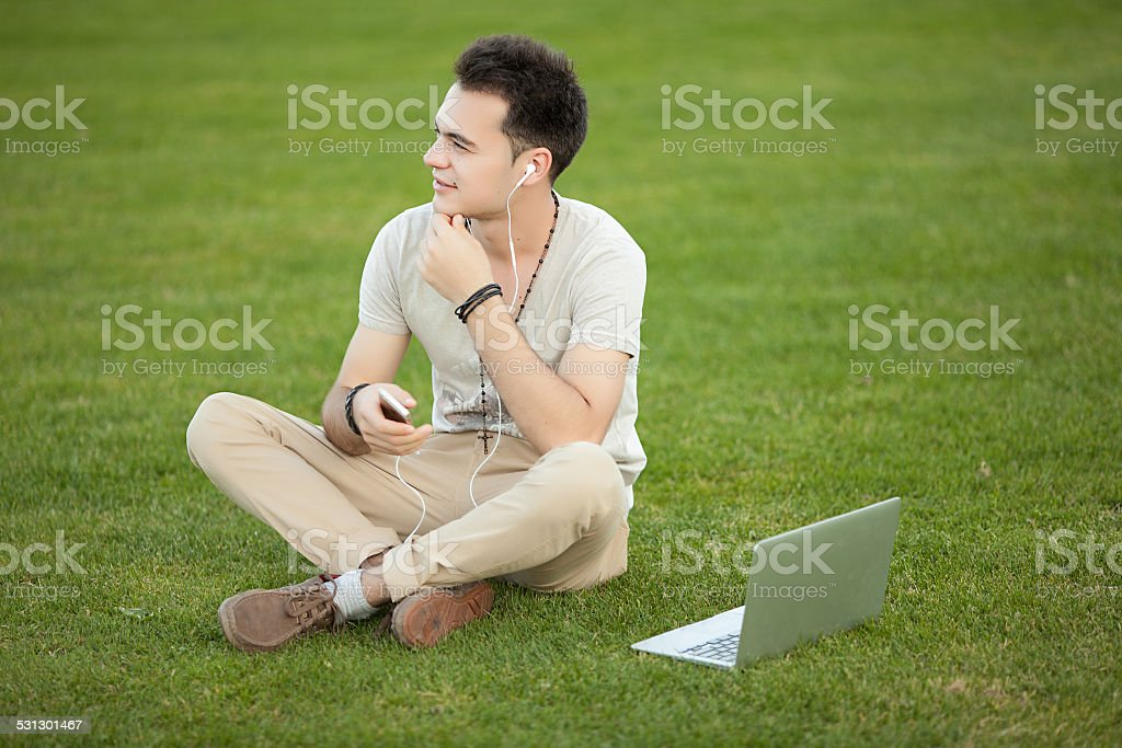 young man with laptop outdoor royalty-free stock photo
