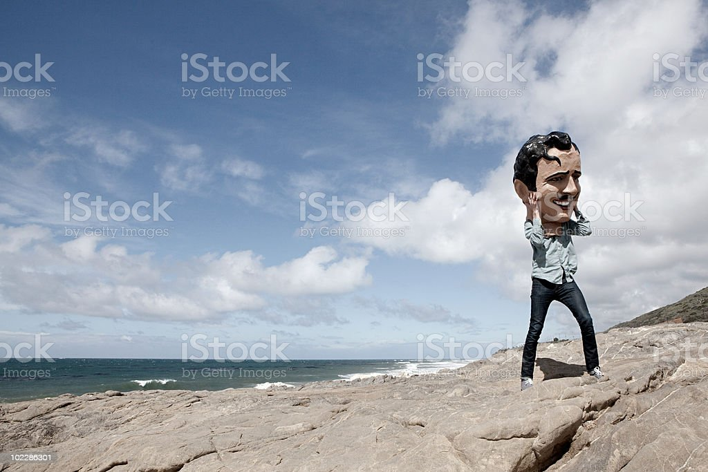 Young man with large head obscuring face royalty-free stock photo
