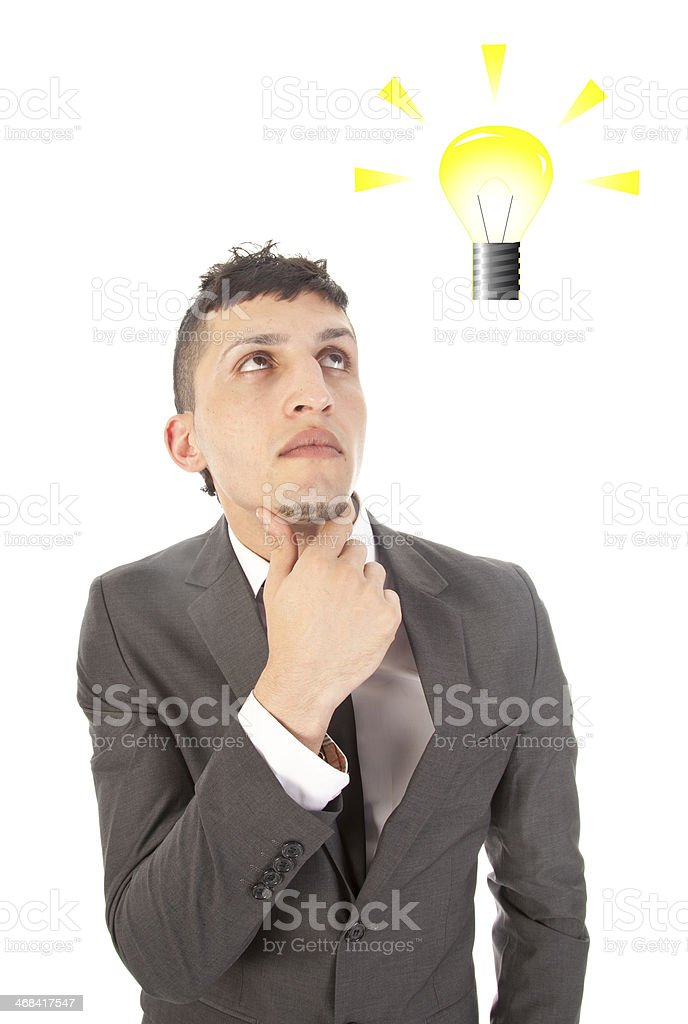 Young man with light bulb isolated on white background royalty-free stock photo