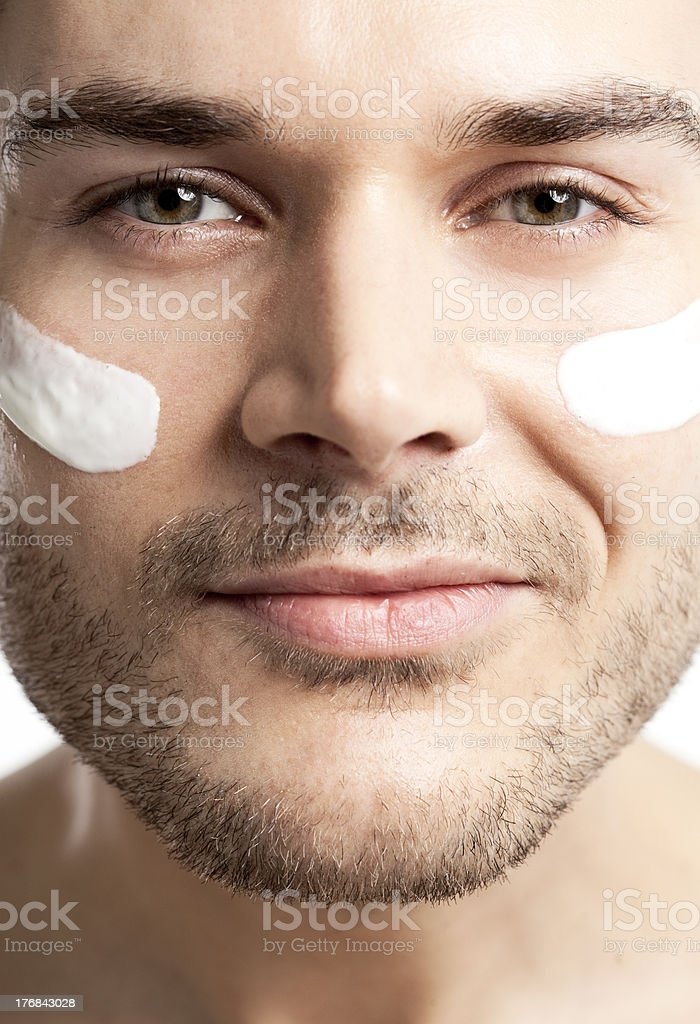 young man with lotion royalty-free stock photo