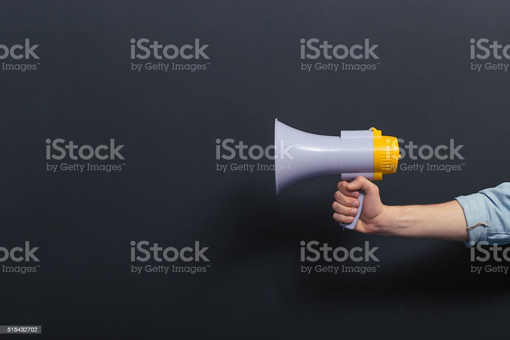 Young man with loudspeaker stock photo