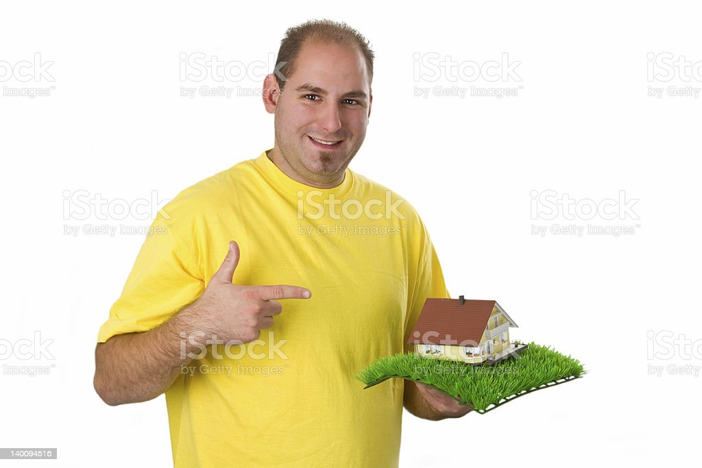 Young man with model house royalty-free stock photo