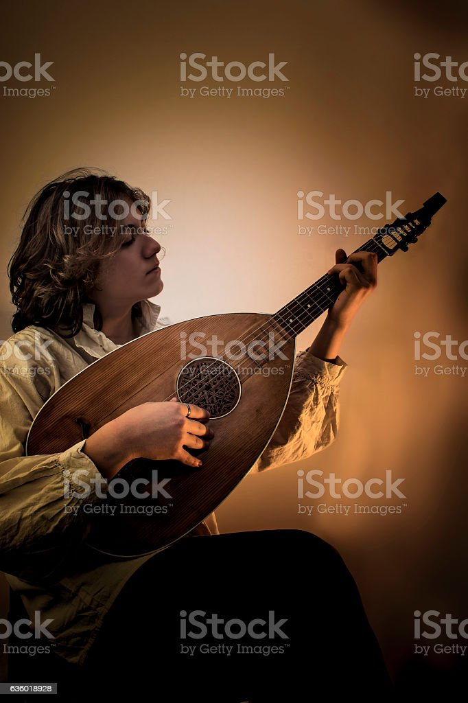 Young Man with Old Oud Guitar Lute stock photo