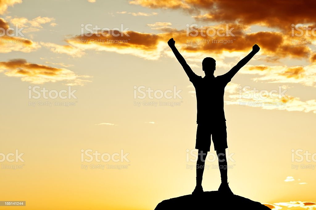 Young man with outstretched arms, sunset scenery after storm (IV) royalty-free stock photo