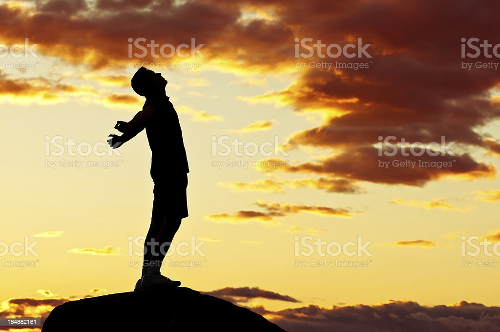 Young man with outstretched arms, sunset scenery after storm (VI) royalty-free stock photo