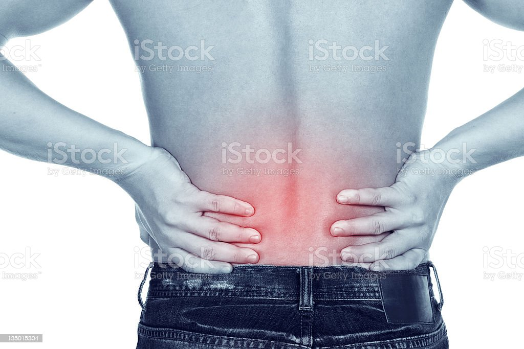young man with  pain in a waist royalty-free stock photo