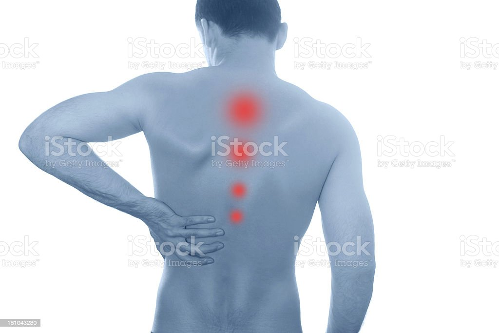 young man with pain in spine ,on a white background. royalty-free stock photo