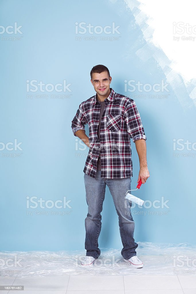 Young man with paint roller royalty-free stock photo