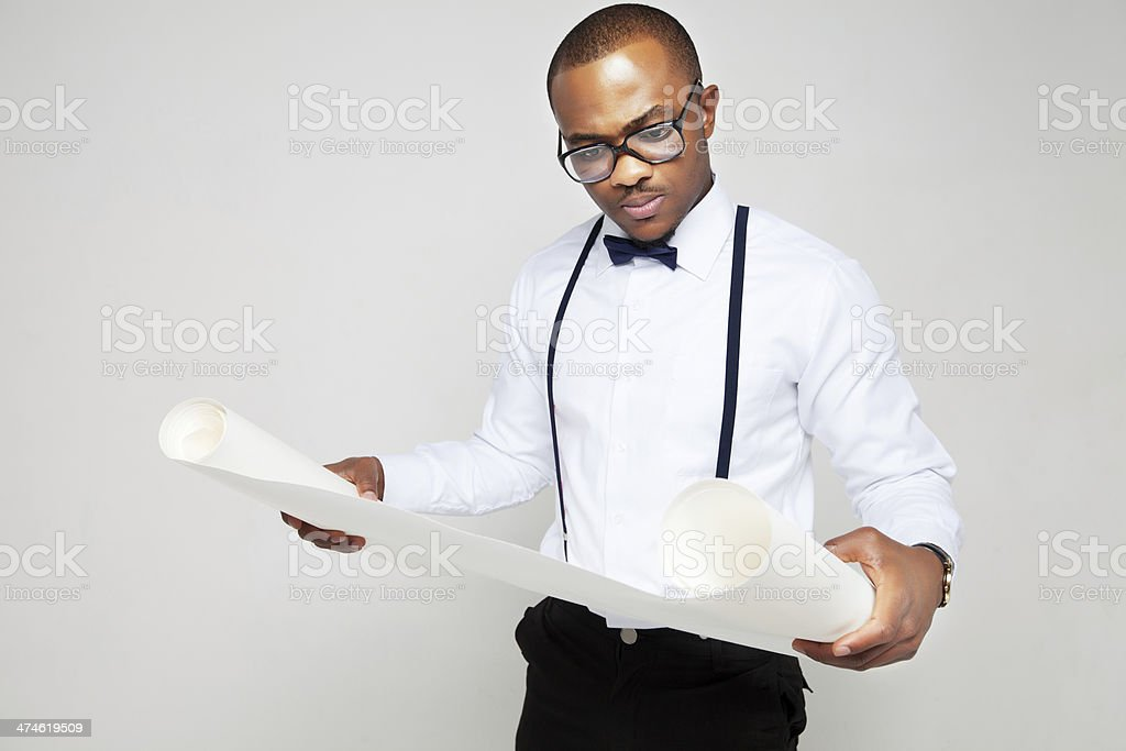 Young man with paper roll stock photo