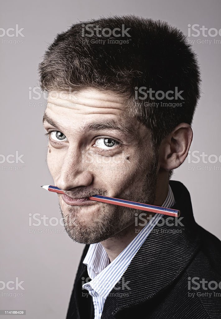 young man with pencil royalty-free stock photo