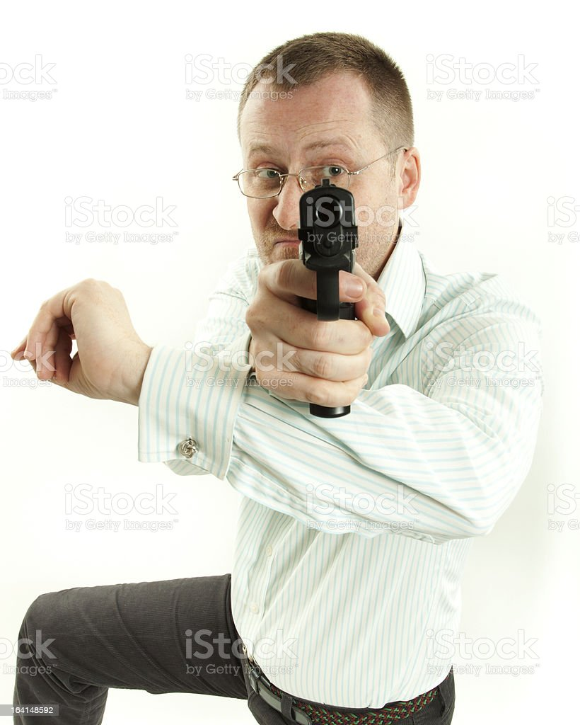 Young man with pistol royalty-free stock photo