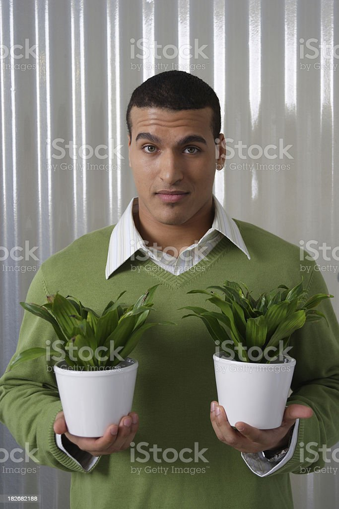 Young man with plant pots royalty-free stock photo