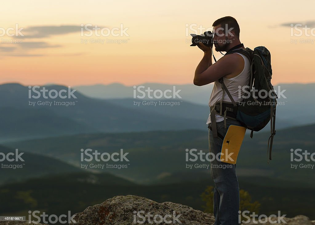 young man with professional camera royalty-free stock photo