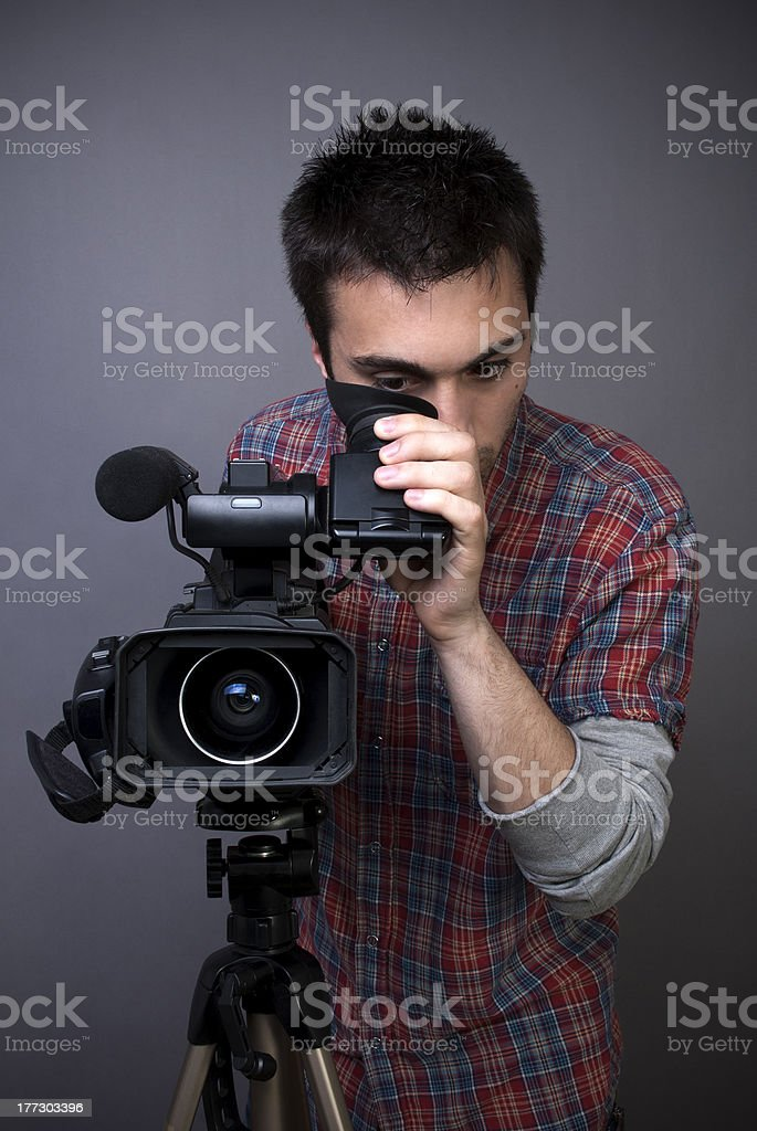 Young man with professional video camcorder stock photo