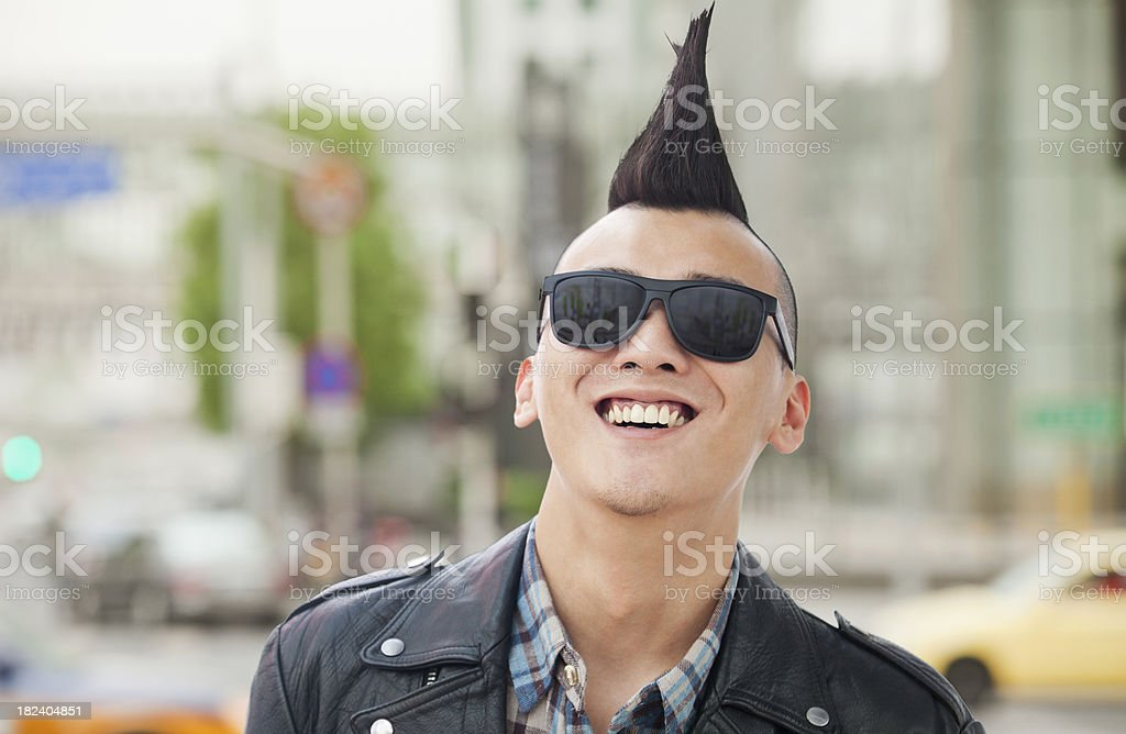 Young man with punk Mohawk smiling stock photo