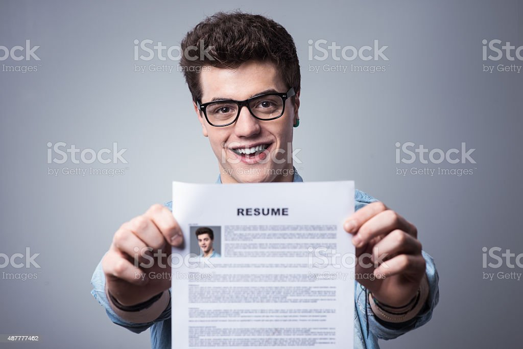 Young man with resume stock photo