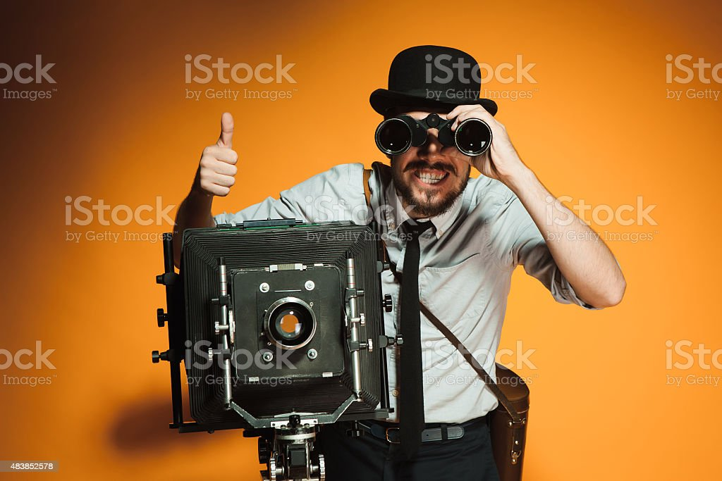 young man with retro camera stock photo