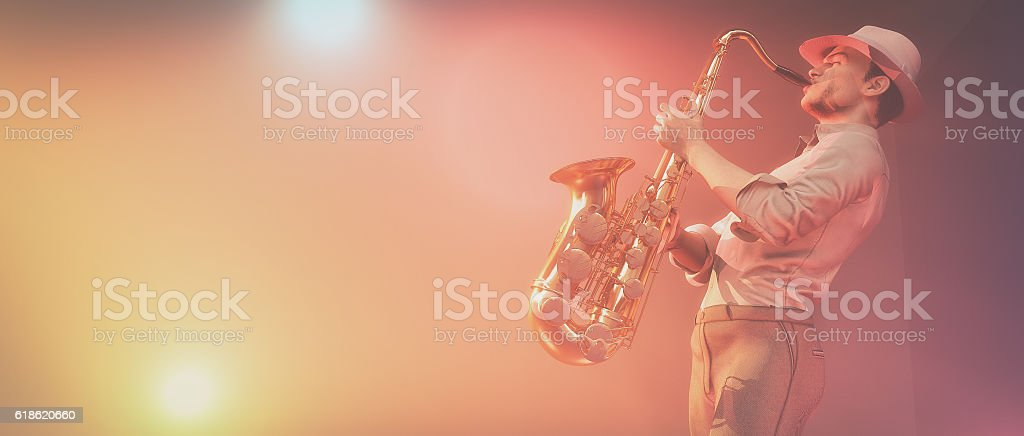 Young man with saxophone stock photo