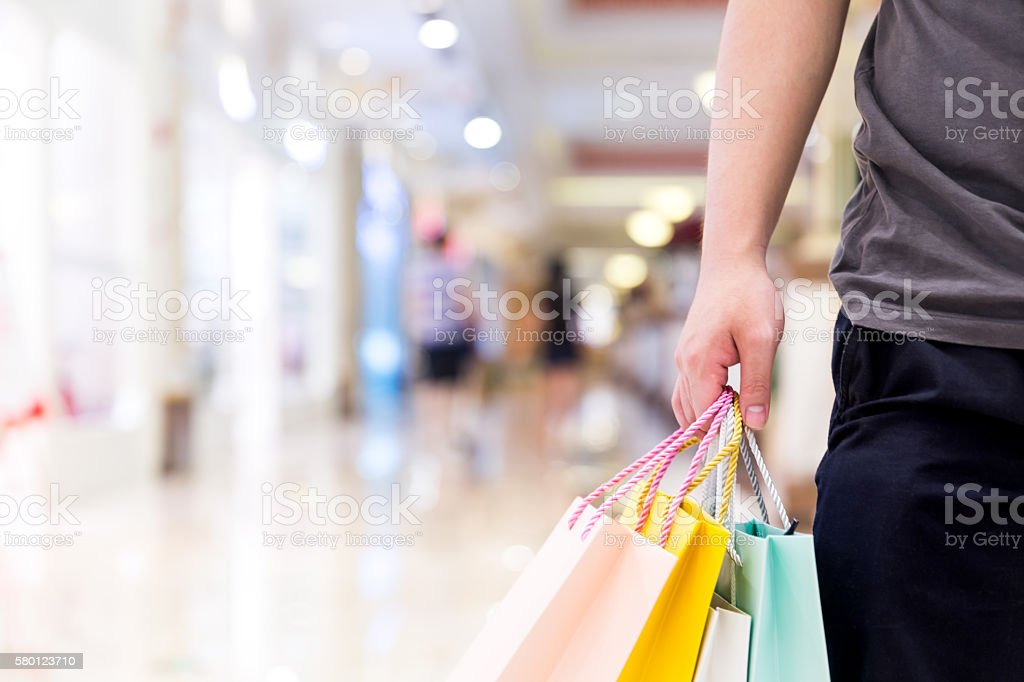 Young Man with Shopping Bags stock photo