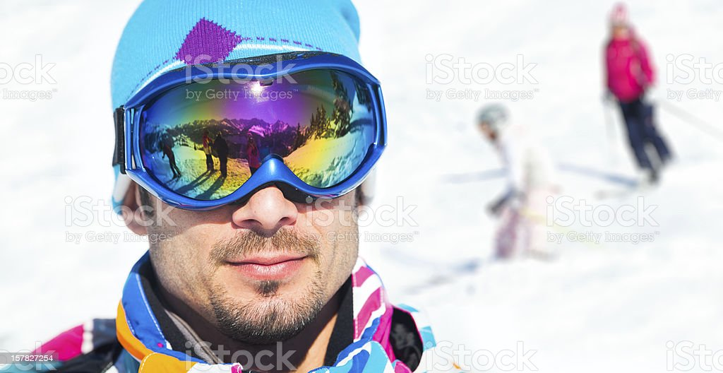 Young man with ski goggles stock photo